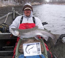 Salmon River Guide, Shane Thomas, with this nice chrome steelhead.